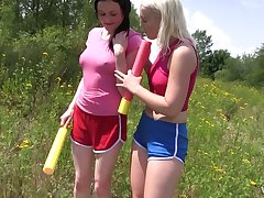 Two surprising girls are corroding each others pussies in the field in broad heyday