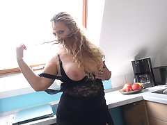 Beate A. licks her huge tits together with pounds herself with a dildo