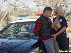 Busty cissified cop treats herself with a big dick