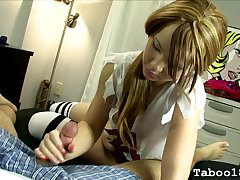 Pigtailed 18 realm old gives a handjob in bed